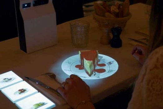 Is it modern to use holograms for customers in restaurants?